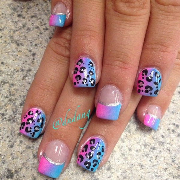Pink and blue colored leopard nail art design. The gradient effects on the pink and blue colors look amazing as they form a periwinkle hue. The contrasting leopard prints are also pleasantly noticeable.