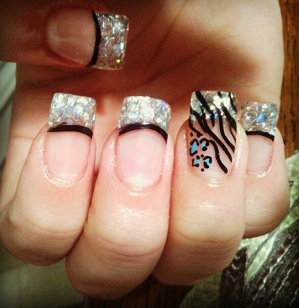 Leopard nail art design and French tips. Make your French tips stand out with this sequin inspired design as well as the blue and black leopard prints along it.