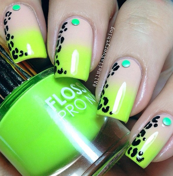 Green inspired leopard nail art design. The gradient theme for the background makes the design look fresh and eye catching. The all black leopard prints also look perfect framing the sides of the nails as the green beads hold the center spots.