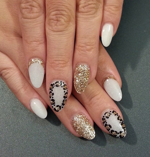 Beautiful white and gold leopard nail art design. A truly elegant looking nail art design. The gold glitter polish perfectly highlights the nails as well as the leopard prints.