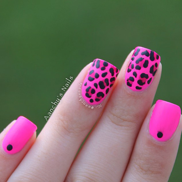 Pink and black leopard nail art design. Pink has always been a hot color and combining it with the black polish only makes it look much more amazing.