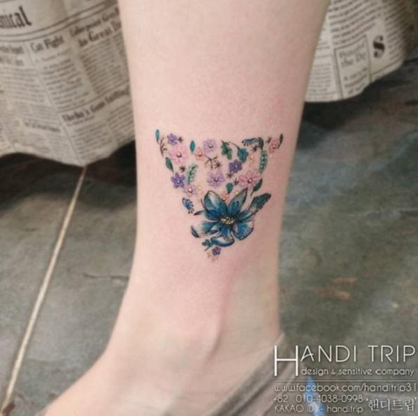 Triangular Glyph Tattoos 20