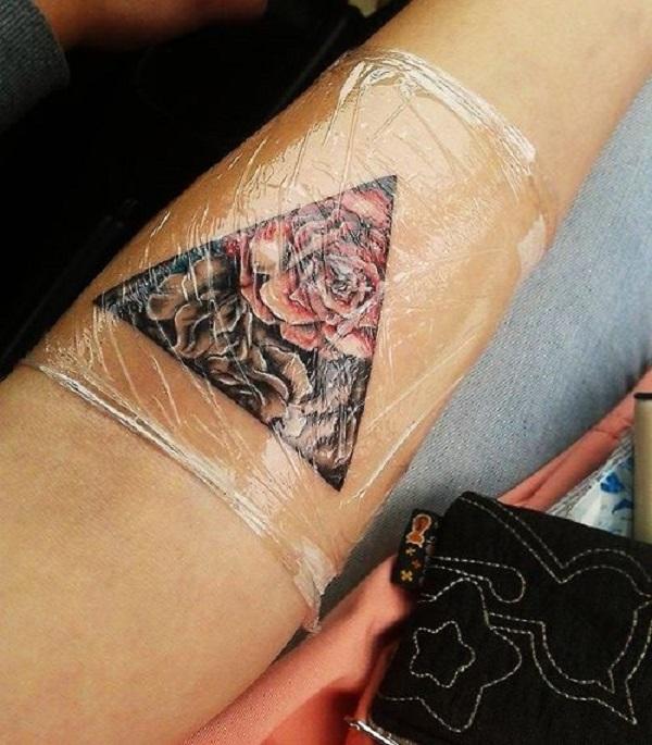 Triangular Glyph Tattoos 32
