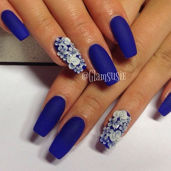 Floral inspired dark blue nail art design. The matte blue nail polish is  contrasted by - 30 DARK BLUE NAIL ART DESIGNS - Nenuno Creative