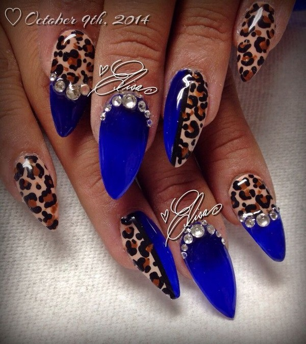 Feisty looking dark blue nail art design. The blues are also designed with  animal prints - 30 DARK BLUE NAIL ART DESIGNS - Nenuno Creative