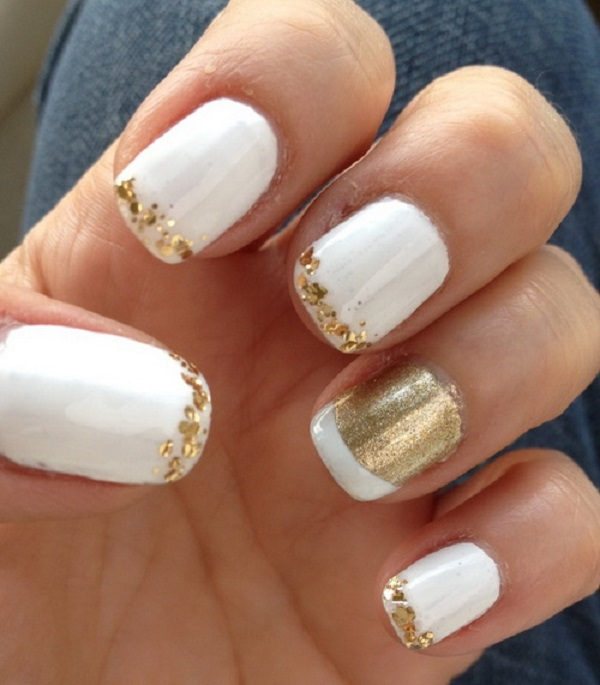 White Nail Art Design Wth Gold French Tips The Are Decorated In Small