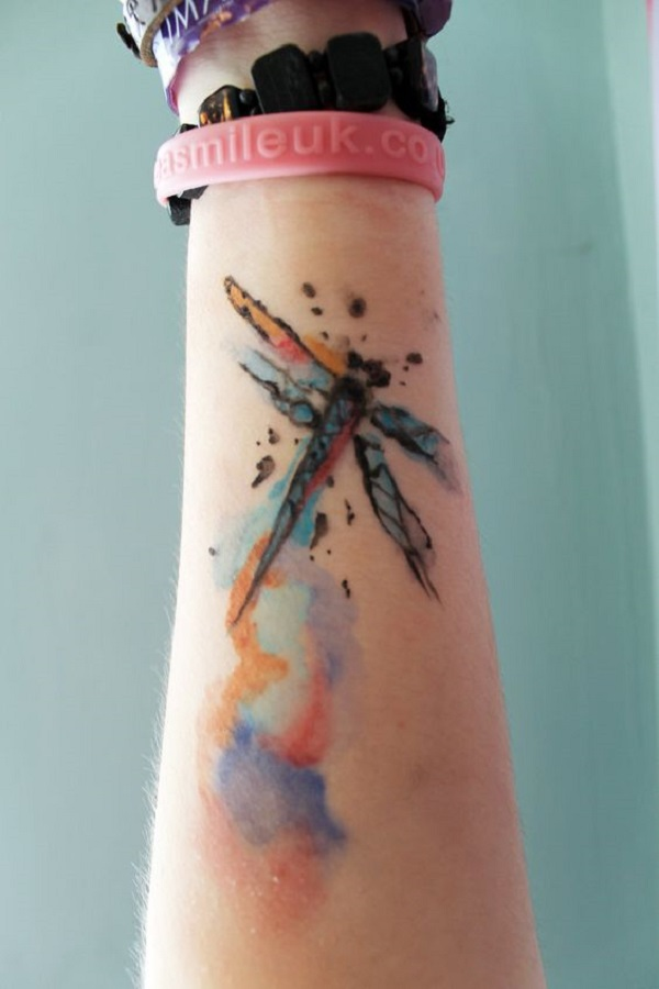 5f6386fb33a17 Interesting and very fun looking dragonfly tattoo on the wrist, the  dragonfly can be seen