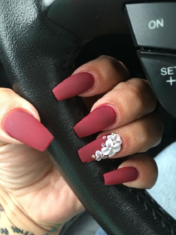 Matte Shade Of Red With Flower On Coffin Nails The White
