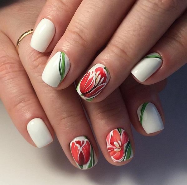 Ці прості весняні цвяхи.  Якщо ви хочете щось просте, але дивно тематичне з весною, то варто придумати цей дизайн нігтів - це оснащено дивовижною грою кольорів і глибинних деталей.  Зростаючі червоні тюльпани на чергових цвяхах з білою основою та зеленими стеблами - це просто вау!