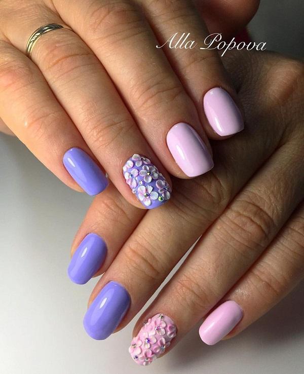 Яскраві та сміливі весняні квіти.  Спробуйте цей дивовижний дизайн мистецтва нігтів, який включає в себе акцентом сміливі рожеві та сині квіти зі шпильками в середині.  Ця неонова дивовижна комбінація, безумовно, приверне певну увагу.