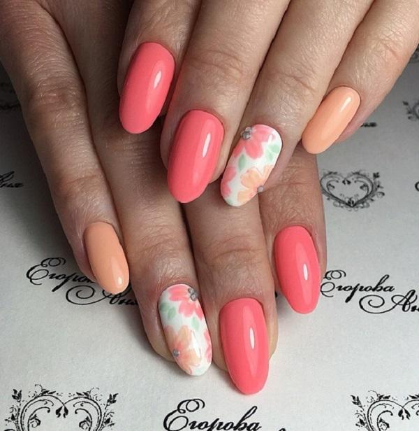 Солодкі весняні квіти  Покращуйте зовнішній вигляд нігтів, намалюючи солодкі весняні квіти на цвяхи різних кольорів.  Тенденція персикового відтінку відбувається цієї весни, так чому б не спробувати це?