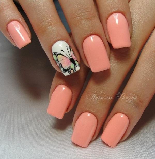 Збільшена метелик  Зробіть комбінацію персика та збільшеної метелики над нігтями, щоб дати вам нігті приємну тему весни.