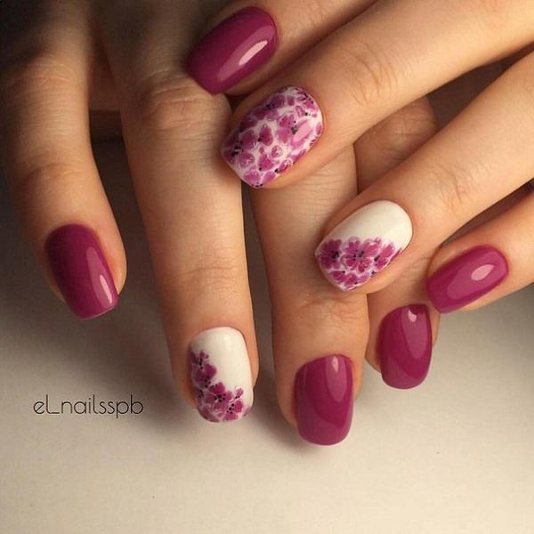 Весняні квіти.  Квіти, особливо кольорові, завжди пов'язані з весною.  Отже, поверніть свої нігті цієї весни з дивовижними рожевими і білими квітами, з деякими пунктирними деталями та різкими контурами.