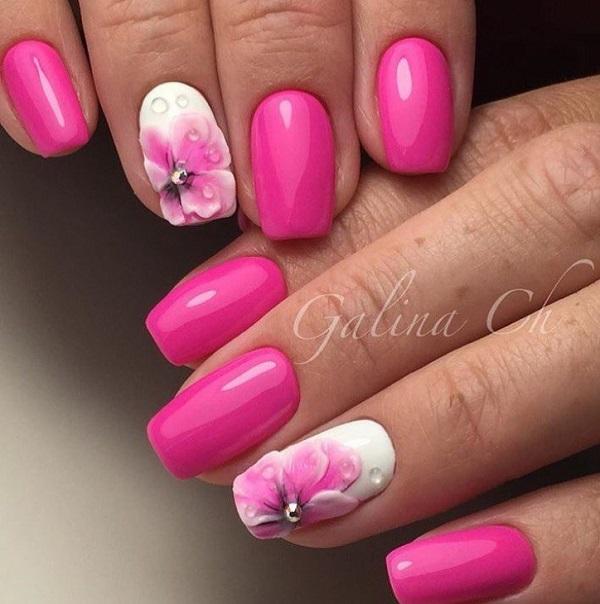 Дощова весна.  Весна - все про п'єсу кольорів і почуттів.  Цей жорсткий рожевий і білий анімаційний дизайн нігтів з тисненням квітів для весни - це ще один чудовий приклад, щоб ваші нігті чудово покрилися чимось незвичайним.