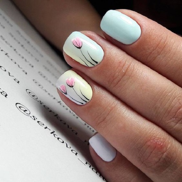 Pink Tulips on White base. These beautiful pink tulips looks effortlessly  beautiful and magnificent in - 60 White Nail Art Designs - Nenuno Creative