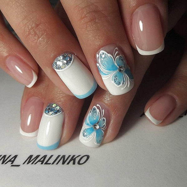 The Blue Butterflied White Nail Art Design. Enhance the look of your nails  with this - 60 White Nail Art Designs - Nenuno Creative