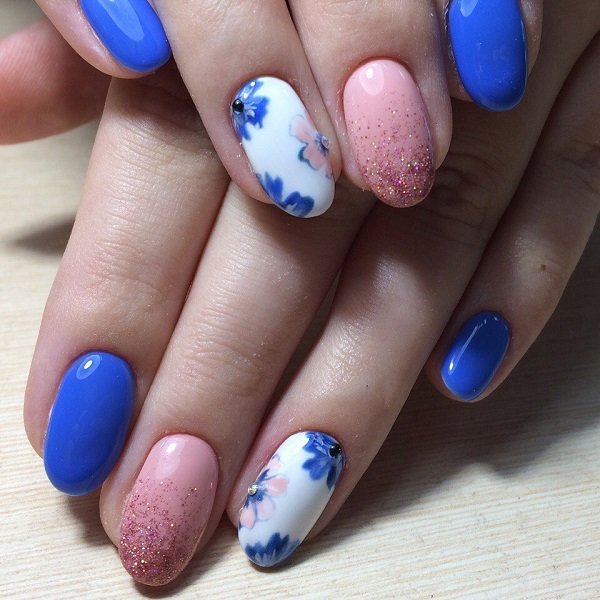 Blue and Pink Floral, glittery nail art design. You might have always seen  blue - 65 Blue Nail Art Ideas - Nenuno Creative
